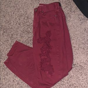 Distressed maroon American Eagle Jeans